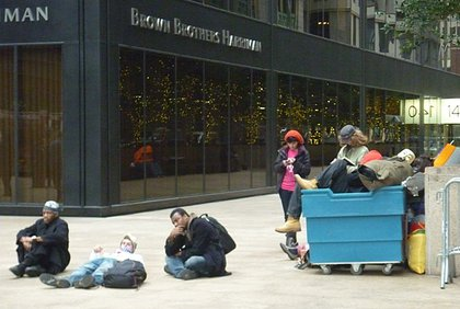 Occupy Wall Street protesters wait to bring their belongings back to Zuccotti Park.