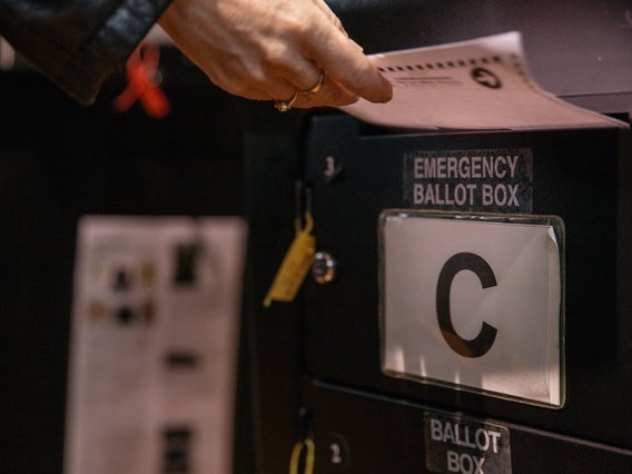 A ballot is stored for scanning later at a poll site in Crown Heights on Election Day.