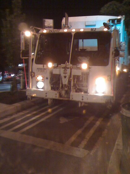 """Sometimes parking in a bike lane just isn't enough. Our bicycling tipster tells us, """"I was riding home on 8th Avenue at in Greenwich Village one evening a few weeks ago when I came up behind this garbage truck at 12th St. Not just blocking the bike lane, but actually driving in it,"""""""