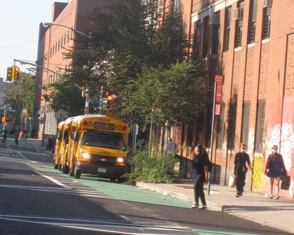 """Jessica G. writes: """"Taken on Kent Ave. in Brooklyn, three buses clearly blocking the lane when all the free parking spots were open. They weren't even picking up kids either, just sitting there idling."""""""
