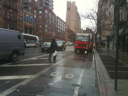 """Patrick Nielsen Hayden, who took this photo, writes: """"8th Ave, between 17th and 18th, around 11 a.m.  The truck,tragically unable to stop anywhere except dead center in the bikelane, is from the Coca-Cola Bottling Company of NY."""""""