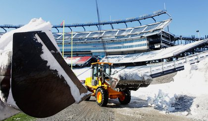 Removing snow from the field at Gillette Stadium