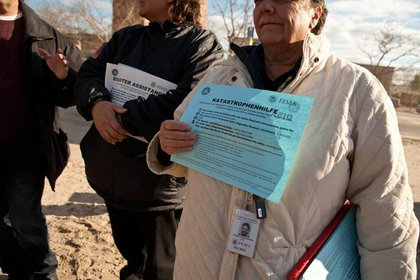 FEMA employees distribute information on how to make a claim