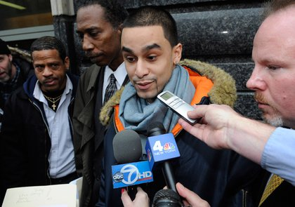 Police brutality victim MIichael Mineo, of Brooklyn, speaks to the media outside Brooklyn state supreme court Tuesday, Dec. 9, 2008, in New York, following the arraignment of three police officers charged with felonies for an attack last Oct. 15 on the tattoo parlor worker.