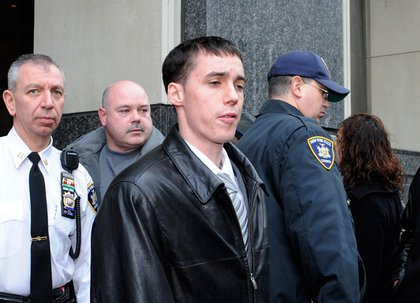 New York City Police officer Richard Kern, front center, exits Brooklyn State Supreme Court following his arraignment, Tuesday, Dec. 9, 2008, in New York. Kern was charged with hindering prosecution and official misconduct for allegedly covering up an attack on a tattoo parlor worker in a subway station.