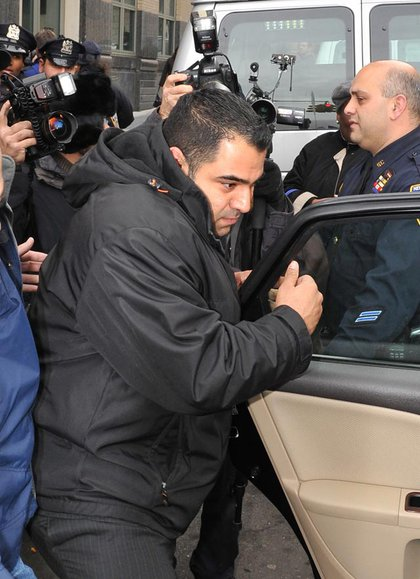 New York City Police officer Andrew Morales exits Brooklyn State Supreme Court following his arraignment, Tuesday, Dec. 9, 2008, in New York. Morales was charged with hindering prosecution and official misconduct for allegedly covering up an attack on a tattoo parlor worker in a subway station.