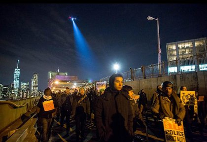 Protesters marching on the Brooklyn Bridge on Saturday night