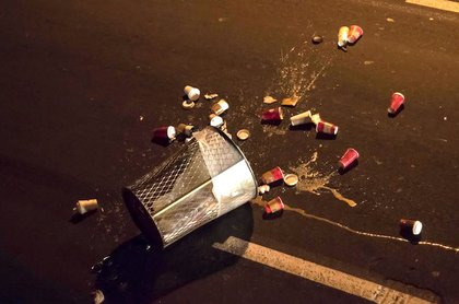 A trash can that was thrown on the Brooklyn-bound roadway
