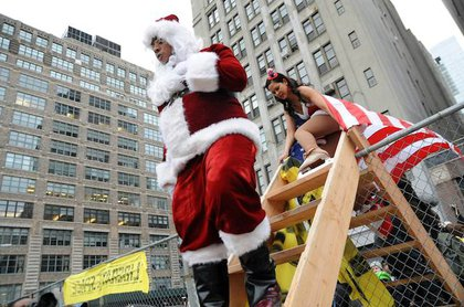 A protester dressed as Santa Claus enters Duarte Square