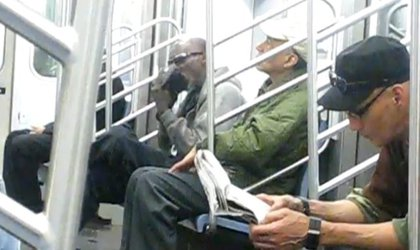 We've already established that most people don't approve of eating on the subway, but what about furiously licking your own shoe?