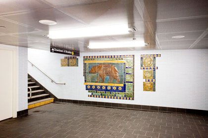 The PATH station might not be built, but the Cortlandt Street station on the R just next door is already open.  It was destroyed on 9/11, and only opened in two stages over the last two years.  This hallway connects the two platforms on the R- the murals are by Margie Hughto and were in the original station- they were salvaged after 9/11 and reinstalled.