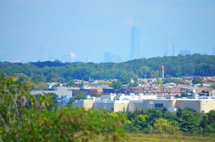 Empire State Building and One World Trade Center as seen from the South Park area of Freshkills Park. That's the Staten Island Mall in the foreground.<br/>