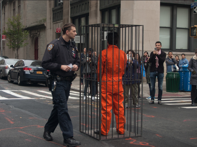 Photos: Artist Locks Himself In Cage In Front Of Manhattan