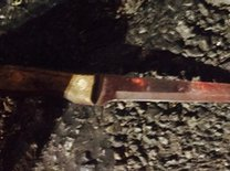 A knife that police say the man officers shot was using to stab his roommate.