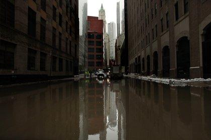 Water floods a street on October 30, 2012 in Lower Manhattan. <br/>