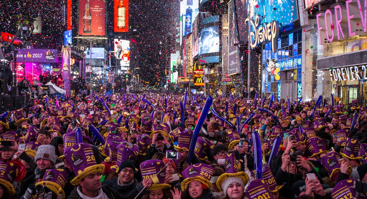 huge crowd of people in times square celebrating new years