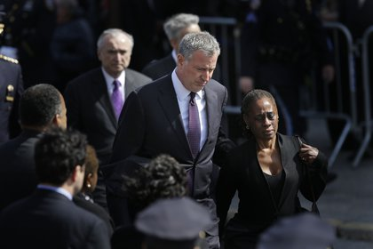 Mayor Bill de Blasio with his wife Chirlane McCray; Police Commissioner Bill Bratton in the background