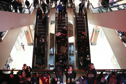 Demonstrators filled two floors of the shopping center and packed the elevators.<br>