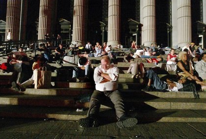 Commuters sleep on steps of the Farley post office (MIKE APPLETON/AP/Shutterstock)