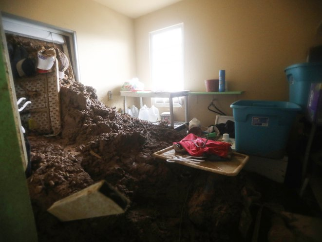 Mud remains in a room of the Reyes family's house after Hurricane Maria hit the island, on October 9, 2017 in Jayuya, Puerto Rico. <br/>