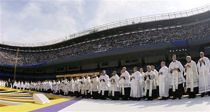 Clergy await to give Communion to over 50,000 people at Yankee Stadium.