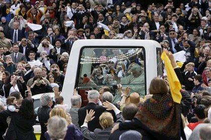 Pope Benedict rides in his Popemobile around Yankee Stadium.