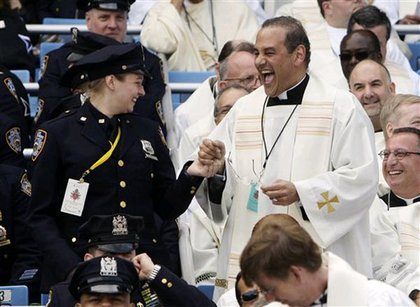 A priest and a police officer dance.