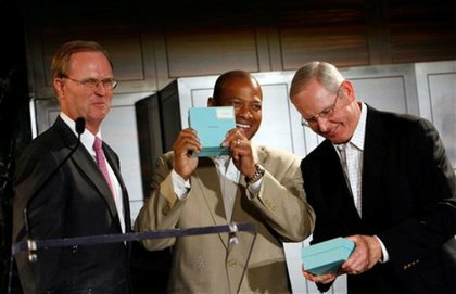 New York Giants co-owner John Mara, left, presents general manager Jerry Reese, center, and head coach Tom Coughlin, right, with their Super Bowl rings at Tiffany.