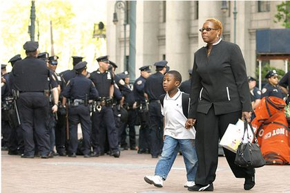 A woman brings her son to the protest at the Brooklyn Bridge.