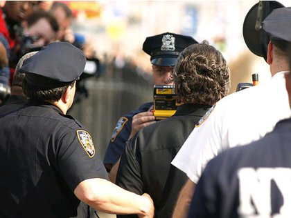NYPD taking a photograph of Sharpton after his arrest.