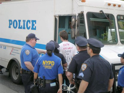A protester is arrested.