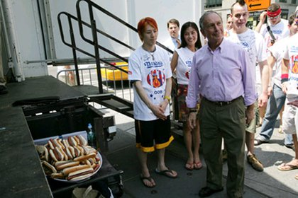 Et tu, trans-fats?  Mayor Bloomberg looks like he's tempted by the hot dogs.