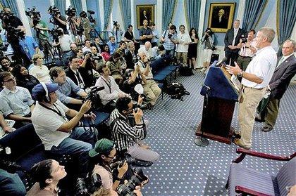 Favre address the media at City Hall.