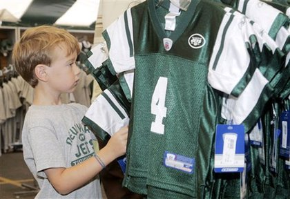 A young fan looks at a new Favre jersey.