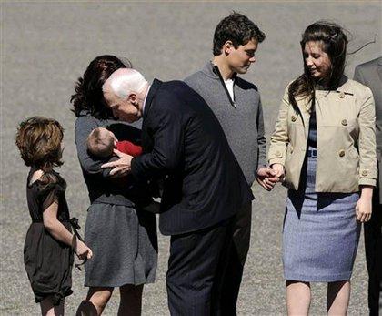 McCain kisses Trig Palin.