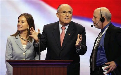 Rudy Giuliani gets ready for his speech with wife Judi at his side.