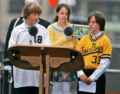 Alex Salamone, left, speaks as his brother, Aiden Salamone, right, and sister, Anna, center, looks on. Their father John Salamone died during the Sept. 11th attacks.