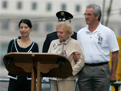 Mariko Koresada, of Japan, left, reads the names of the victims of the Sept. 11, 2001 attacks with Jean Hoffman, center. This year, the victims' names were read by family members a person from one of the 115 countries victims hailed from.