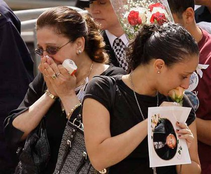 Relatives mourn during the ceremony.