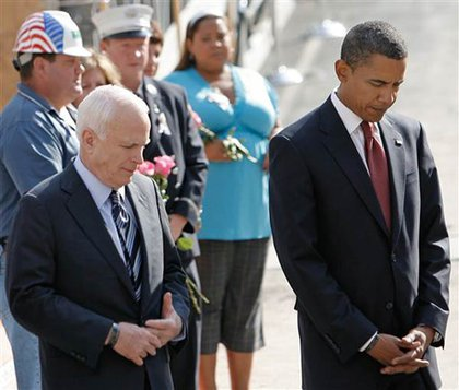 McCain and Obama bow their heads.