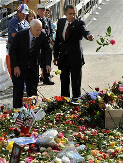 McCain and Obama throw flowers into the pools.