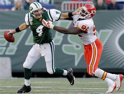 The Jets' Brett Favre tries to get away from Kansas City Chiefs defensive end Tamba Hali.