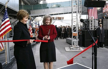 First lady Laura Bush and Sally Hoover Casale, granddaughter of the original dedicators of the U.S.S. Intrepid, cut the ribbon during the rededication ceremony