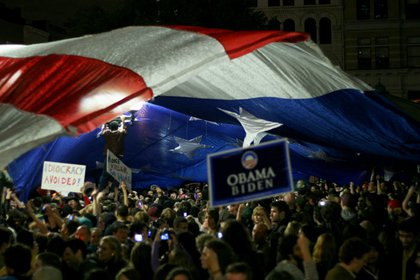 A flag is unfurled by the crowd in Union Square