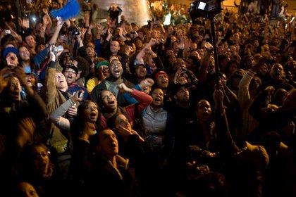 People cheering in Harlem