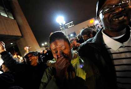 A woman is overwhelmed with news of Obama's victory in Harlem
