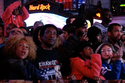 A crowd in Times Square watches the returns