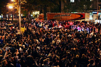 Students gather on Broadway and West 115th Street outside Columbia University