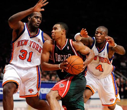 Photograph of Knicks  Malik Rose (31) and Nate Robinson (4) guarding against Milwaukee Bucks' Ramon Sessions