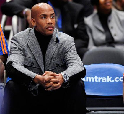 Stephon Marbury, in street clothes and on the bench again
